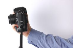 Hand and camera Royalty Free Stock Photo