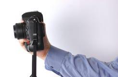 Hand and camera Royalty Free Stock Photo