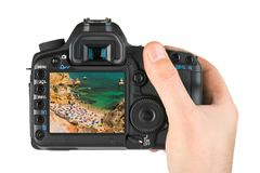 Hand with camera and Beach in Lagos - Algarve Portugal - Portuga. L my photo isolated on white background Stock Images