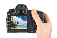 Hand with camera and beach landscape (my photo) Royalty Free Stock Photography