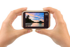 Hand with camera and beach landscape (my photo) Stock Photography