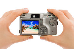 Hand with camera and beach landscape (my photo) Stock Image