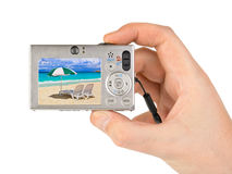 Hand with camera and beach landscape (my photo) Stock Photo