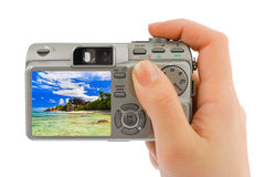 Hand with camera and beach landscape (my photo) Royalty Free Stock Image