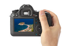 Hand with camera and Island Sveti Stefan - Montenegro image (my Stock Photography