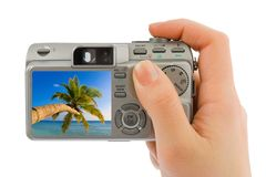 Hand with camera and landscape (my photo) Royalty Free Stock Photos