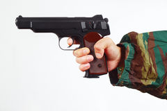 Hand in camouflage uniform with army gun on white background Stock Image