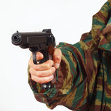 Hand in camouflage uniform with army handgun on white background Royalty Free Stock Photography