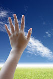 Hand can be seen in the five inches on Beautiful prairie sky. Royalty Free Stock Image
