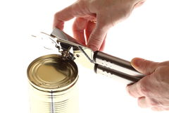 Hand and can with can opener Stock Image