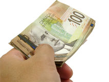 Hand and canadian dollar Stock Photos