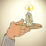 Hand with candle. Royalty Free Stock Image