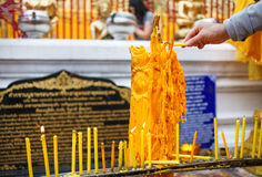 Hand with candle in Wat Doi Suthep Buddhist Temple in Ciang Mai, Stock Photography