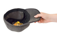 Hand and cap with money Stock Photo