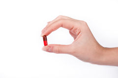 Hand with capsule. The Woman's hand is holding red,brown capsule royalty free stock images