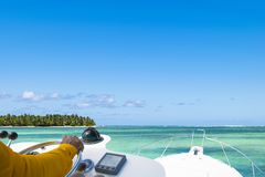 Hand of captain on steering wheel of motor boat in the blue ocean during the fishery day. Success fishing concept. Ocean yacht. Hand of captain on steering stock photos