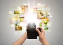 Hand captures life events with digital camera Stock Photos