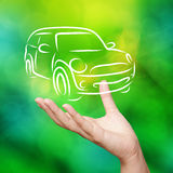 Hand with car against green nature Stock Images