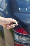 Hand with a car alarm remote control Stock Photos