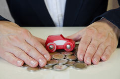 Hand, car and coins Royalty Free Stock Photos