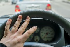 Hand of the car driver on the steering wheel stock photos