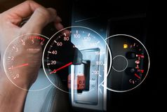 Hand with car gear stic with speedmeter car dashboard Stock Image