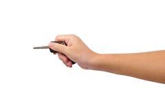 Hand and car key Stock Photos