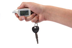 Hand and car key Royalty Free Stock Images