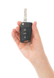 Hand with car key isolated Royalty Free Stock Images