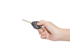 Hand and car key isolated on white background.  Royalty Free Stock Photo