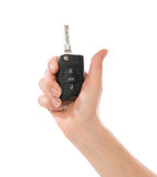 Hand with car key isolated Stock Image