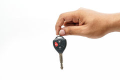 Hand with a car key. Isolated on white background. Stock Photo