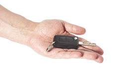 Hand with a car key Stock Images
