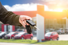 Hand with a car key. Royalty Free Stock Photos