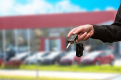 Hand with a car key. Royalty Free Stock Image