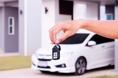 Hand with a car key. Male hands holding with a car key Royalty Free Stock Image