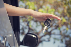 Hand with car key Stock Images