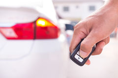 Hand with a car key. Hand with a car key on the road Stock Photos