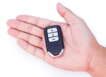 Hand with a car key. Hand with a car key on white background Stock Photo