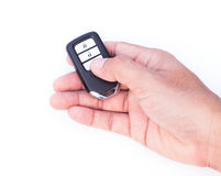 Hand with a car key. Hand with a car key on white background Stock Photography