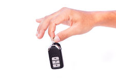 Hand with a car key. Hand with a car key on white background Stock Images