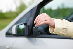 Hand with car keys. Hand showing keys out the car window Stock Image