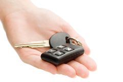 Hand with car keys. On a white Stock Image