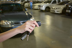 Hand with a Car keys in car park Stock Photo