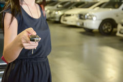 Hand with a Car keys in car park. Hand with a Car keys in the indoor car park Royalty Free Stock Photography