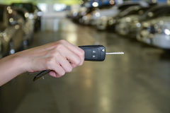 Hand with a Car keys in car park Royalty Free Stock Photos