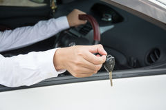 Hand with a car keys in car. Transpotation Royalty Free Stock Photo
