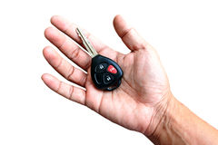 Hand with a Car keys. Isolated on white background Royalty Free Stock Photography
