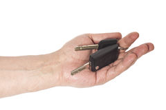 Hand with a car keys isolated on white. Background Royalty Free Stock Photo