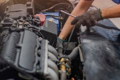 Hand of car mechanic check the car engine royalty free stock images